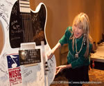 Becky adds her name to the Oklahoma Music Hall of Fame guitar.